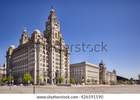 Liverpool, England: 14 May 2016 - The Three Graces, historic buildings which dominate the Liverpool waterfront at Pier Head - Royal Liver Building, Cunard Building,  Port of Liverpool Building.