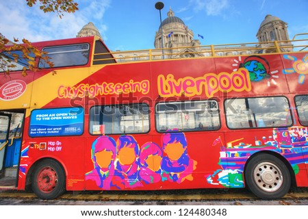 LIVERPOOL, ENGLAND - OCTOBER 29 - Sightseeing bus with colourful pictures of Beatles  in the city centre takes visitors to all the major tourist attractions in Liverpool, October 29, 2012. - stock photo