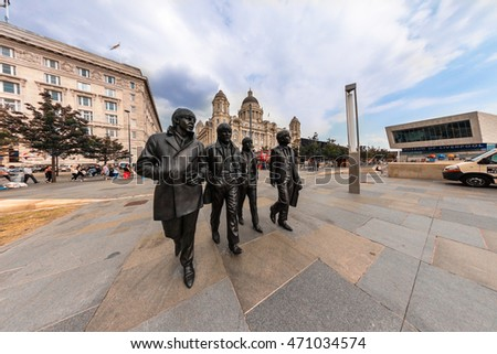 LIVERPOOL, UK - AUGUST 18, 2016:  Bronze statue of the four Liverpool Beatles stands on Liverpool Waterfront by sculptor Andrew Edwards.  Fish eye perspective.