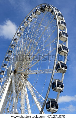 LIVERPOOL, UK - JULY 27,2016: The magnificent Ferris Wheel of Liverpool over blue sky.