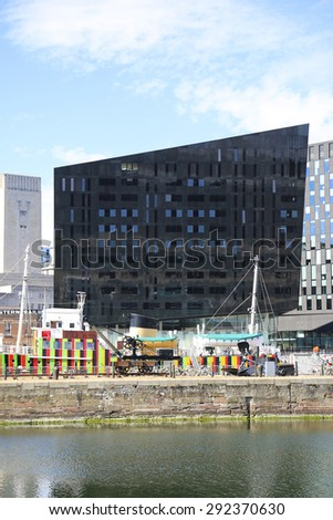LIVERPOOL, UK - JUNE 30, 2015: Commercial building fronting onto Canning docks, Liverpool.. Liverpool is a city in Merseyside, England, on the eastern side of the Mersey Estuary - stock photo