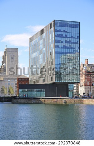 LIVERPOOL, UK - JUNE 30, 2015: Commercial building fronting onto Canning docks, Liverpool. Liverpool is a city in Merseyside, England, on the eastern side of the Mersey Estuary - stock photo