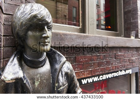 LIVERPOOL, UK. JUNE 09, 2016: Profile portrait of statue of John Lennon at entrance to The Cavern Club, on Mathew Street, where The Beatles played their first concert. - stock photo
