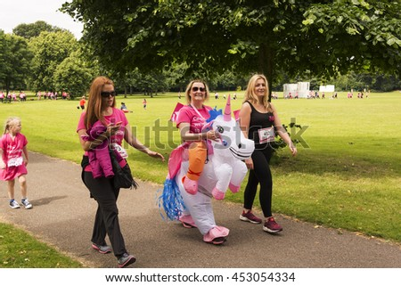 Liverpool, UK - June 26, 2016: Race for Life sponsored fun run for British charity Cancer Research UK. Groups and Family undertake their run or walk in fancy dress- Editorial - stock photo