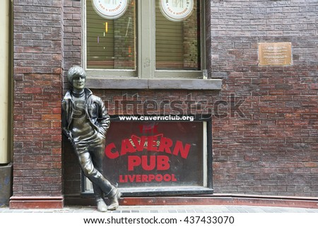LIVERPOOL, UK. JUNE 09, 2016: Statue of John Lennon at entrance to The Cavern Club, on Mathew Street, where The Beatles played their first concert. - stock photo