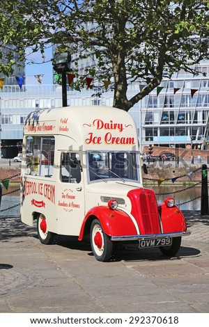 LIVERPOOL, UK - JUNE 30, 2015: Vintage ice cream van at Albert Dock. The Albert Dock is a major tourist attraction in the city and the most visited multi-use attraction in the UK, outside of London. - stock photo