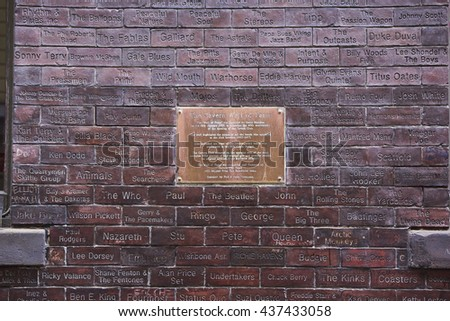 LIVERPOOL, UK. JUNE 09, 2016: Wall of fame plaque at entrance to The Cavern Club, where The Beatles played their first concert. The wall features names of famous bands that performed in the venue. - stock photo