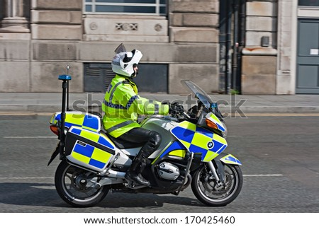 LIVERPOOL, UK, MARCH 24, 2012. British motorcycle policeman on active duty - stock photo