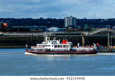 LIVERPOOL, UK - 30 March 2016: The Mersey Ferry, MV Royal Iris of the Mersey passes the Liverpool shoreline.