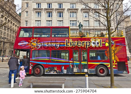 LIVERPOOL, UK - MAY 3, 2015: Sight seeing open top bus at the city centre decorated with images of local attractions. - stock photo