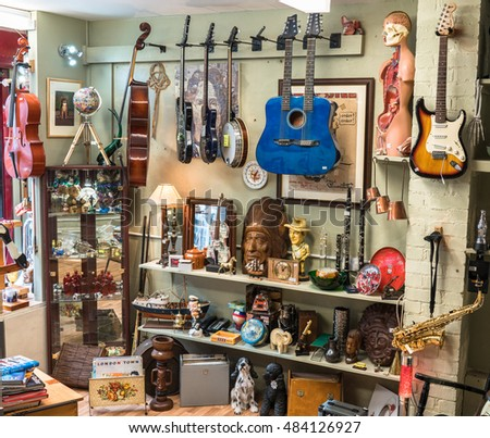 LIVERPOOL, UK - OCT 10: Various musical instruments and collectables for sale in a second hand shop. October 10, 2015.