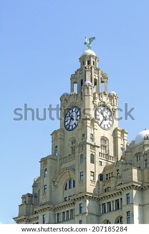 LIVERPOOL, UK - 24th JULY 2014: The Liver building is one of the Three Graces. The Three Graces are on the Liverpool waterfront and recognised as an Unesco World Heritage Site  - stock photo