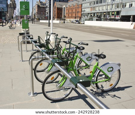 LIVERPOOL, UNITED KINGDOM - JUNE 23: bicycles of the City Bike public cycle hire scheme on June 23, 2014 in Liverpool, United Kingdom. Liverpool's City Bike scheme launched in May 2014.  - stock photo