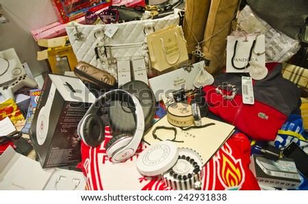 LIVERPOOL, UNITED KINGDOM - JUNE 23: seized fake designer merchandise on June 23, 2014 in Liverpool, UK. Millions of pounds worth of fake merchandise are seized by the authorities in the UK each year. - stock photo