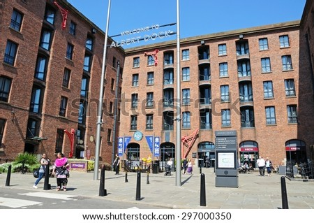LIVERPOOL, UNITED KINGDOM - JUNE 11, 2015 - Tourists outside The Beatles Story building at Albert Dock, Liverpool, Merseyside, England, UK, Western Europe, June 11, 2015. - stock photo