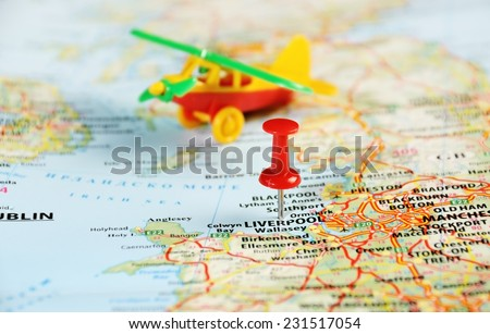 Liverpool  ,United Kingdom map with red pin and airplane toy  - Travel concept - stock photo