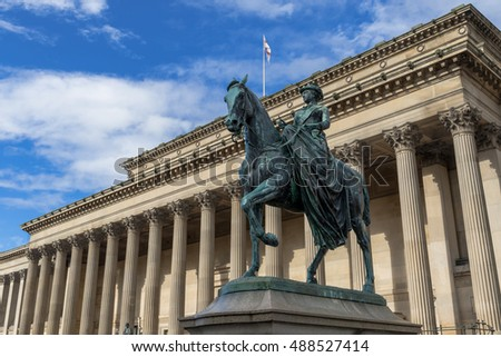 LIVERPOOL, UNITED KINGDOM - SEPTEMBER 8, 2016: Queen Victoria statue in front of St. George's Hall