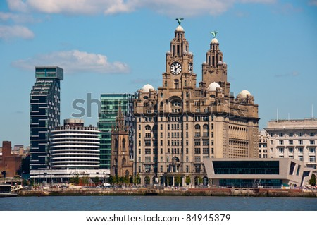 Liverpool Waterfront showing Liver Building and Ferry Terminal. - stock photo