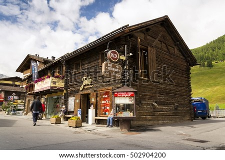 LIVIGNO, ITALY - AUGUST 1: Tourists shopping on the streets of duty-free area on 1 August 2016 in Livigno, Italy.