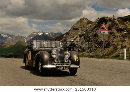 LIVIGNO, ITALY - JUNE 13: A brown Triumph Roadster 1800 takes part to the Summer Marathon classic car race on June 13, 2014 in Livigno. This car was built in 1948 - stock photo