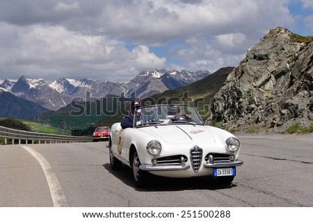 LIVIGNO, ITALY - JUNE 13: A white Alfa Romeo Giulietta spider and a red Alfa Romeo 1900 Super Sprint take part to the Summer Marathon classic car race on June 13, 2014 in Livigno.Both were built in 56 - stock photo