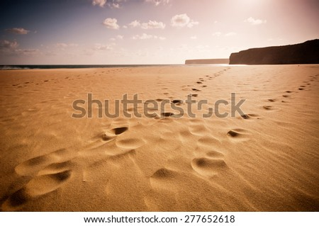 Living a journey in algarve portugal in a solitary beach, walking. - stock photo