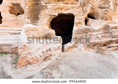 living ancient cavern  in Little Petra, Jordan - stock photo