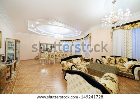 Living and dining room with luxury furniture in classic style. - stock photo
