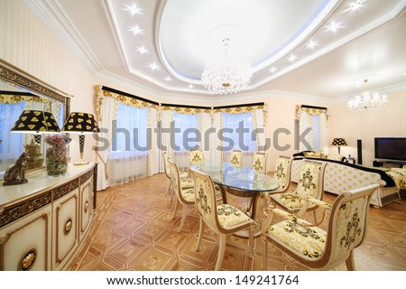 Living and dining room with luxury gilt furniture in classic style. - stock photo