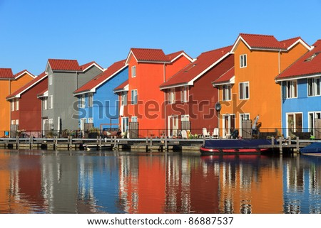 Living at the water, it is typical Dutch. Colorful houses and blue sky.