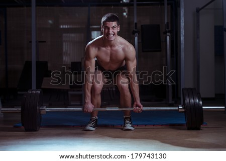 Living Large - Muscular Man Lifting Deadlift In The Gym - stock photo
