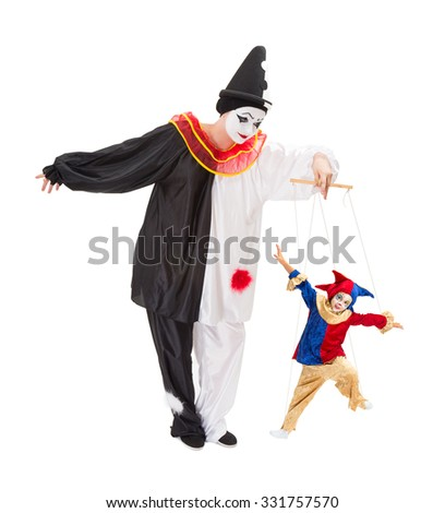 Living marionette clown on strings and a live pierrot doll - stock photo