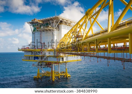 Living quarter and bridge connect to central processing platform for oil and gas industry. - stock photo
