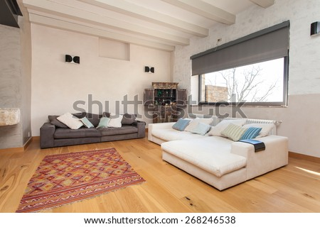 living room and dining area of a modern villa in countryside - stock photo