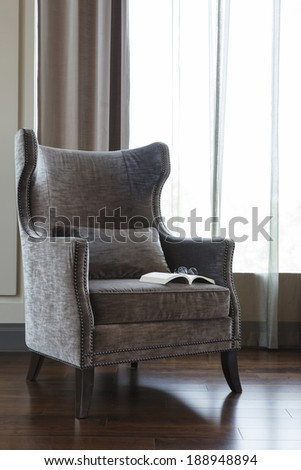 Living room armchair with book at Hotel lobby - stock photo