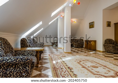 Living room attic interior with carpet and painting - stock photo