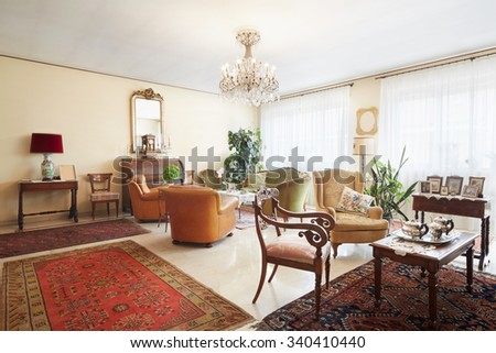 Living room, classic italian interior with antiquities - stock photo