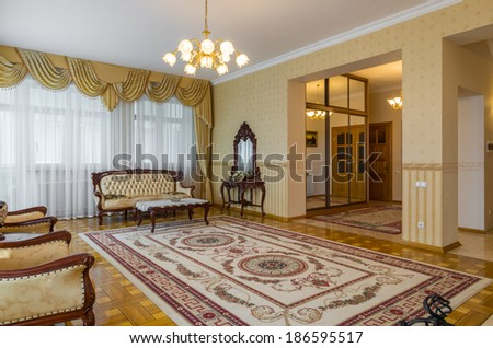 Living room classicism yellow interior with carpet