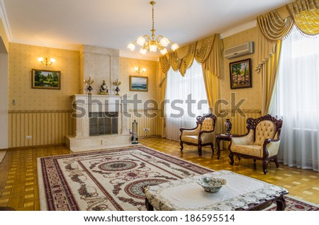 Living room classicism yellow interior with carpet, fireplace - stock photo