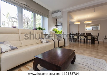 Living room connected with dining room in new house - stock photo