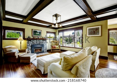 Living room design idea. Coffered ceiling blend with stone trim fireplace and rustic rocking bench - stock photo