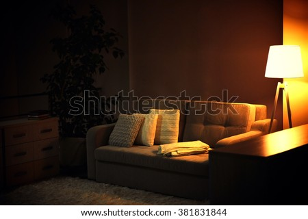 Living room design with sofa and lamp - stock photo
