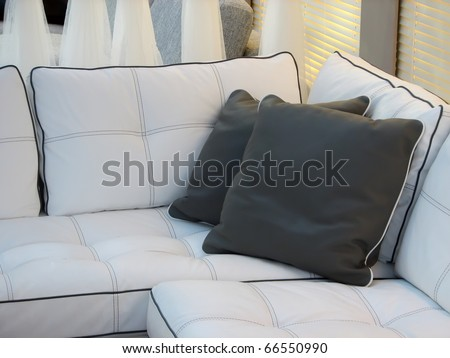 Living room furniture. Leather furniture. Leather couch with pillows. - stock photo