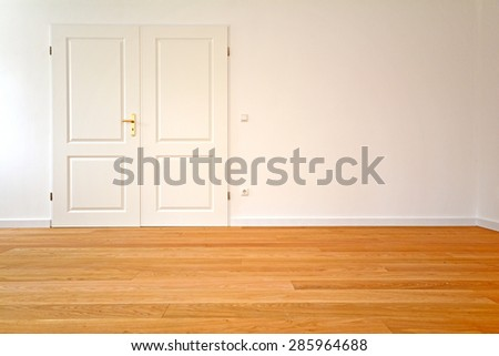 Living room in an old building - Apartment with double door and wooden floors - stock photo