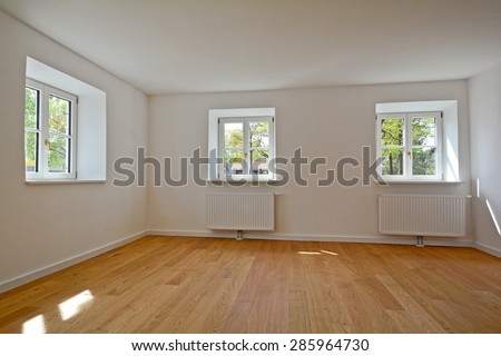 Living room in an old building - Apartment with wooden windows and parquet flooring after renovation - stock photo