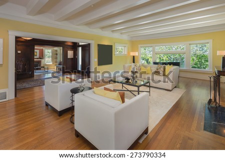 Living room in Luxury home with fire place and gorgeous, high coffered ceilings with white wooden beams. - stock photo