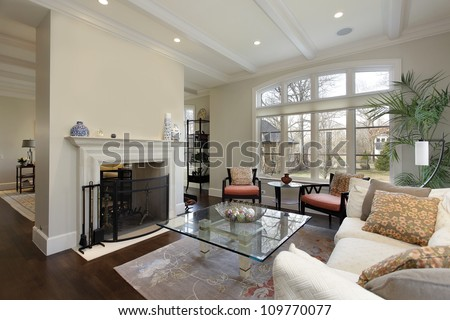 Living room in luxury home with fireplace