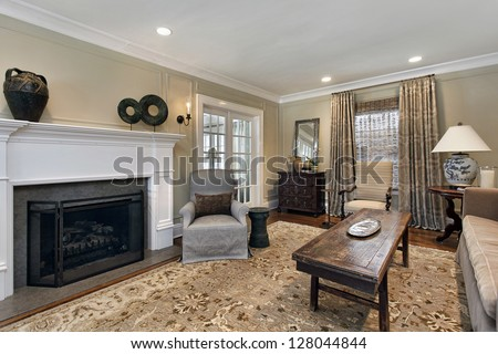 Living room in upscale home with fireplace - stock photo