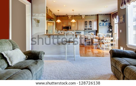 Living room interior near kitchen with two sofas. - stock photo