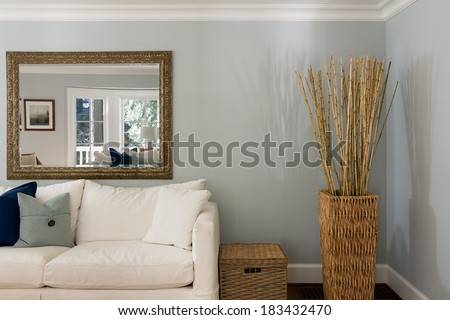 Living room interior with couch and basket. - stock photo